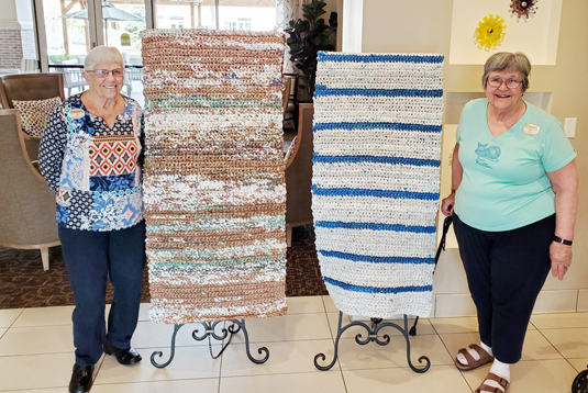 Residents at MorningStar at RidgeGate with their hand-woven plastic bag mats for Denver's homeless.