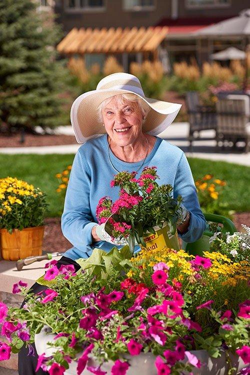 Senior woman smiling while gardening