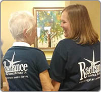 Picture of two women with shirts that say Radiance